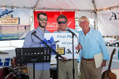 Dick Franyo and Charlie Ebersberger from Anglers Sports Center present Rockfish Tournament #Rockfish Tourney first place winner with prizes